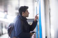 Man looking at timetable on platform - SGF02168