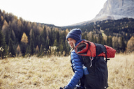Happy young woman hiking in the mountains - PNEF00441