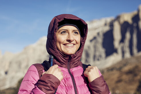 Portrait of confident young woman hiking in the mountains - PNEF00447