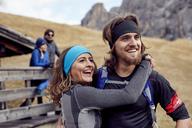 Happy friends having a break at mountain hut - PNEF00471