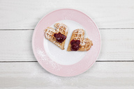 Homemade waffels with cherries, waffel hearts for two on plate - GWF05418
