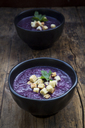 Bowl of red cabbage soup garnished with croutons and leaf of parsley - LVF06659