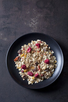 Bowl of fruit granola with dried raspberries, strawberries and cranberries - CSF28871
