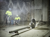 Construction workers sawing with a concrete saw - CVF00099