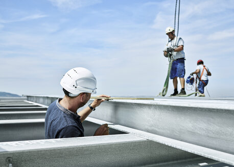 Construction worker checking steel girder - CVF00102