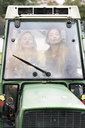 Two woman in tractor, pouting - PESF00942