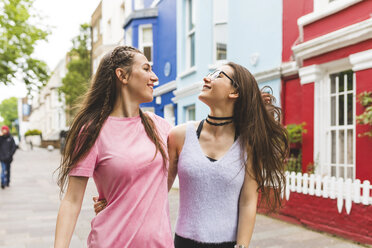 Two happy teenage girls on the go in the city - WPEF00014