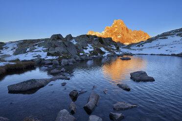 Italy, Trentino, Dolomites, Passo Rolle, Pale di San Martino range, mountain peak Cimon della Pala in the evening light - RUEF01810