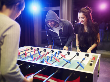 Happy friends playing foosball - CVF00104