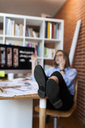 Young woman working in architecture office, talking on the phone - VABF01481