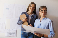 Female architects working on a project, looking confident - VABF01490