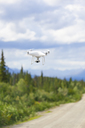 USA, Alaska, Denali Highway, Flying drone with camera - MMAF00271