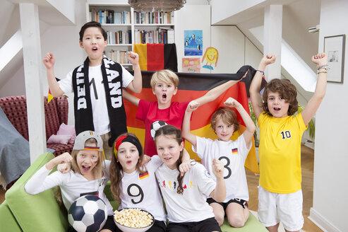 Group of kids watching soccer world championship, cheering - NEKF00013