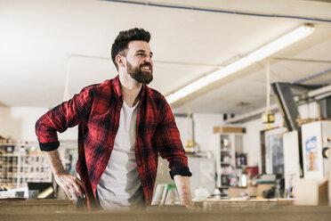 Portrait of smiling man in workshop - UUF12718
