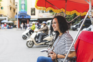 Vietnam, Hanoi, happy young woman on a riksha exploring the city - WPEF00057