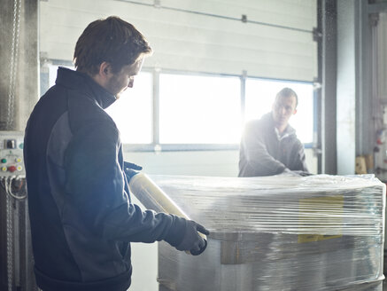 Workers closing freight with foil - CVF00111