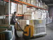 Man operating pallet jack in storehouse - CVF00135