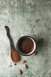 Cup of chocolate pudding with cacao, cacao nibs and cocoa beans - MYF02004