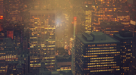 USA, New York, Manhattan, high-rise buildings at night - DAPF00886