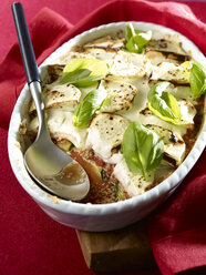 Courgette gratin with goat cheese, sesame in gratin dish, low carb - SRSF00639