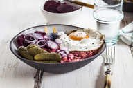 Labskaus, rollmops, pickled gherkin, beetroot salad, onion and fried egg - SBDF03460