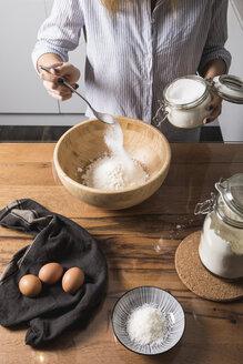 Woman preparing dough at home - MAUF01333