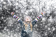 Happy girl at snowfall - SARF03545