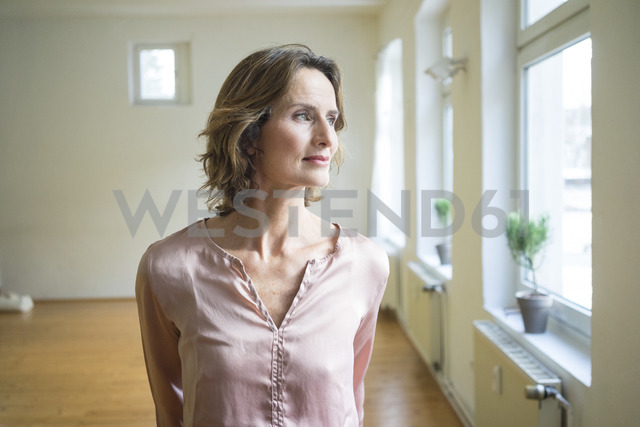 Pensive mature woman in empty room - MOEF00745