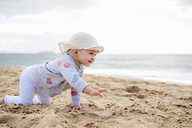 Spain, Lanzarote, baby girl crawling on the beach - DIGF03288