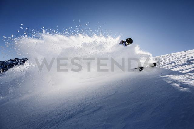 Austria, Tyrol, Mutters, skier on a freeride in powder snow - CVF00138