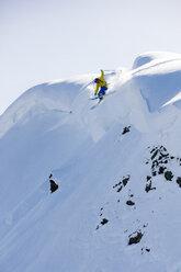 Austria, Tyrol, Alpbach, skier on a freeride jumping above snowdrift - CVF00141