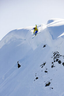 Austria, Tyrol, Alpbach, skier on a freeride jumping above snowdrift - CVF00141