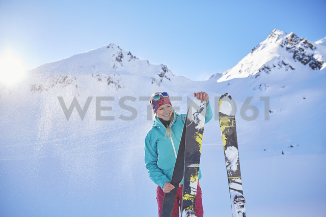 Austria, Tyrol, Kuehtai, freeride skier preparing ski for a ski tour - CVF00144