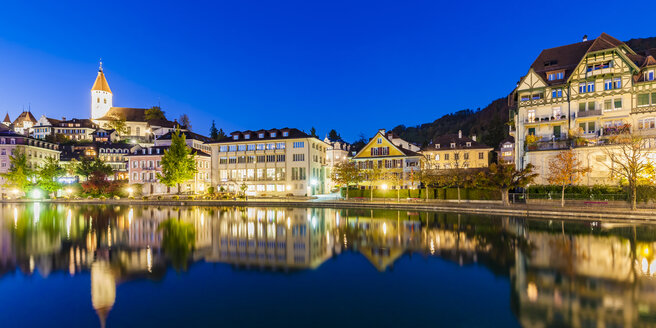 Switzerland, Canton of Bern, Thun, river Aare, old town with parish church and Aarequai at blue hour - WDF04435