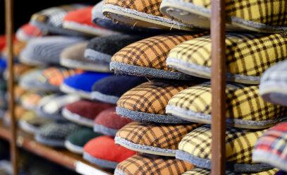 Slippers on shelf in cobbler's shop - BFRF01815