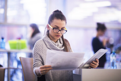 Portrait of young woman working in an office - SGF02177