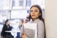 Portrait of young woman on the phone - SGF02180