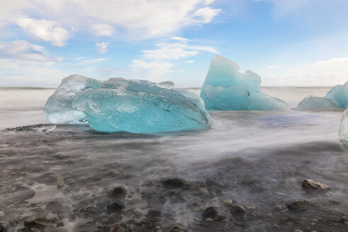 Iceland, Hof, black sand beach with ice pieces - WPEF00104