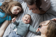High angle view of family looking at cute baby girl - FSIF00081