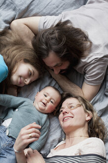 High angle view of family looking at cute baby girl - FSIF00096
