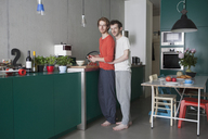 Full length portrait of young gay couple in kitchen - FSIF00198