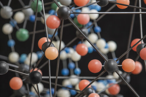 Close-up of multi colored molecular structure over white background - FSIF00261