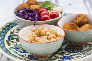 Hummus, sweet potato balls, Couscous and vegetables in bowls - LVF06688
