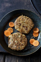 Veggie burger and carrot slices in frying pan - CSF28900