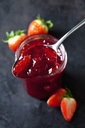 Spoon of strawberry jam, close-up - CSF28915