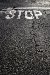 'Stop' sign on tarmac - LCF00025