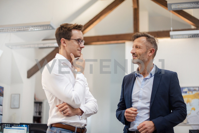 Two businessmen talking in office - DIGF03316