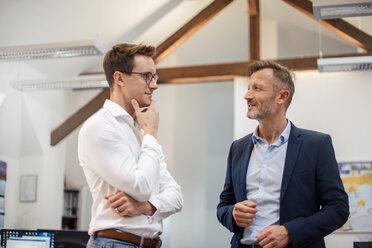 Two businessmen talking in office - DIGF03316