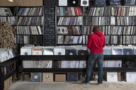 Rear view of young man in a record store - FSIF00369