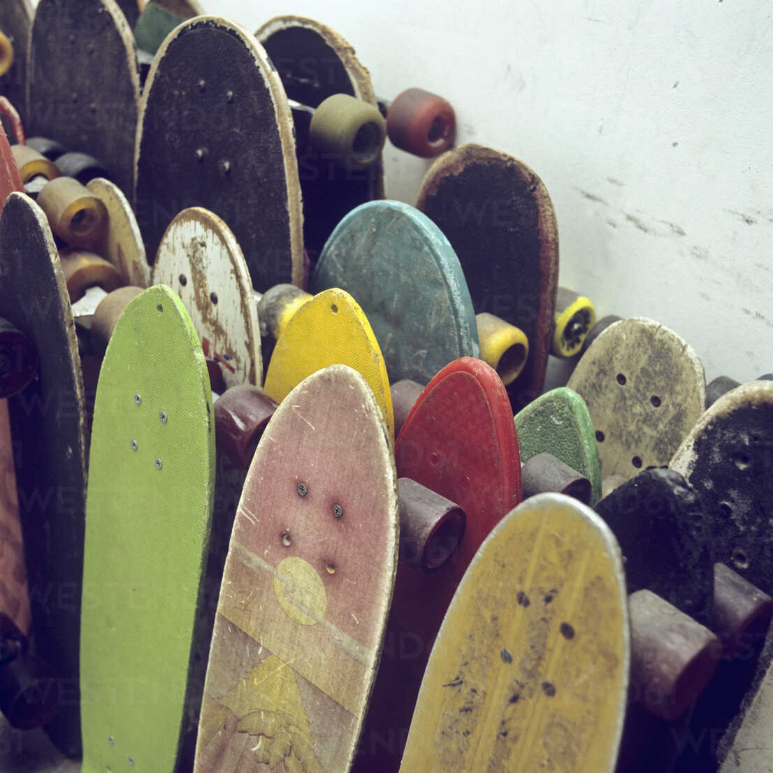 Rows of used skateboards leaning against a wall - FSIF00375 - fStop/Westend61